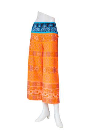 pleat: Orange pants isolated on white background.