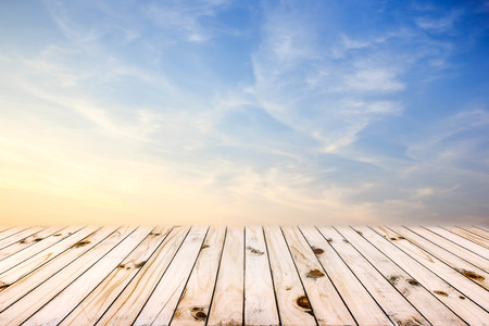 old wood floor: Beautiful blue sunset sky and old wood floor background.