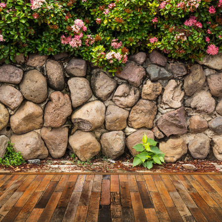 Wooden decking with stone wall garden decorative. Stock Photo