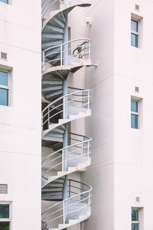 escape: Fire escape stairs in apartment.