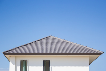 building a new roof of home, blue sky as background Stock Photo