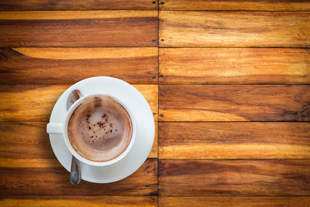 Empty hot coffee cup after drink on wood table. Stock Photo