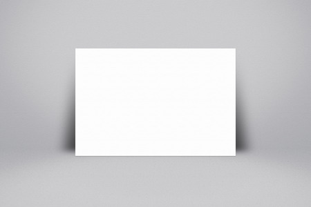 according: White paper poster on abstract grey background. For text input or according to your design. Stock Photo