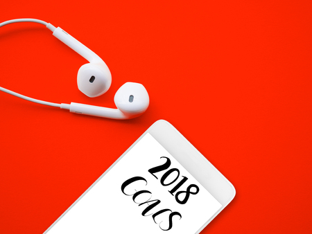 2018 GOALS on smart phone with white earphones on red background