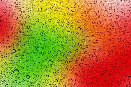 Rain water drop on colourful window glass background Stok Fotoğraf