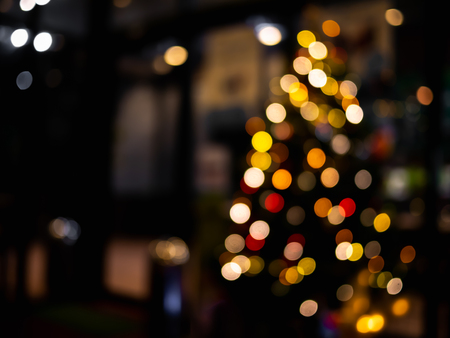 Abstract light bokeh Christmas tree for background.