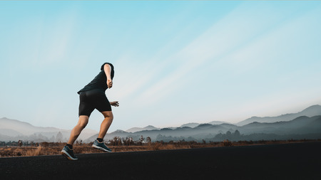 Young man enjoy running outside with beautiful summer evening in the countryside. Imagens