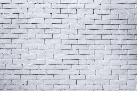 Antiguo muro de ladrillos blancos para textura y fondo.