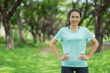 Beautiful asian woman is exercising in the park. 写真素材
