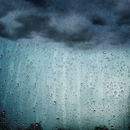 Rain water drops on window glass texture background