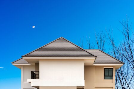 Building a new roof of home with blue sky background. Stock Photo