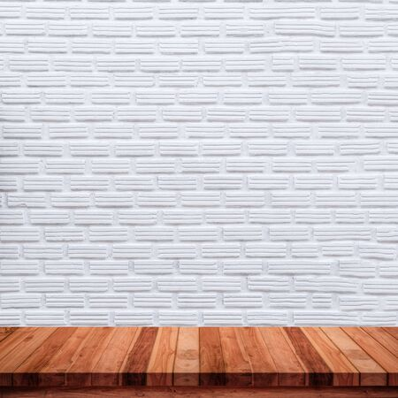 Empty wooden table with white brick wall background. For display or montage your products
