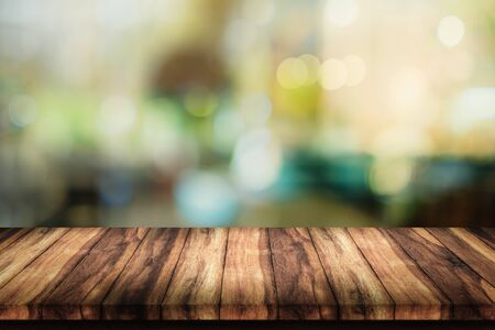 Empty top of wood table with blur cafe or coffee shop background. Stock Photo
