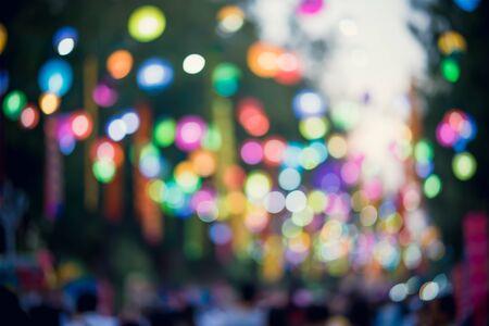 Blur image of tourists walk in night market