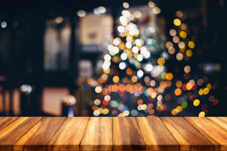 Wood table top on blur Christmas tree background. For display or montage your products.