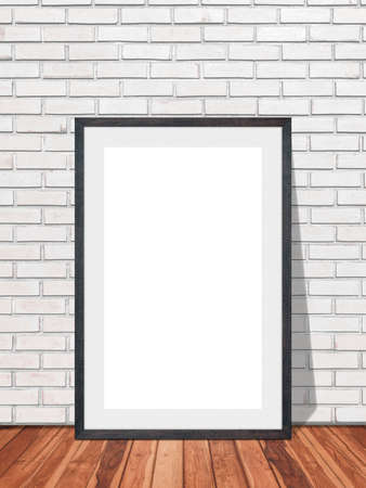Black blank frame in white brick wall with wooden floor texture interior room background, Mockup template for your content or design.