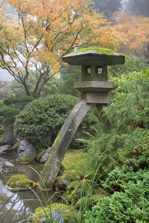 zen stones: Stone Lantern by the Pond in Japanese Garden