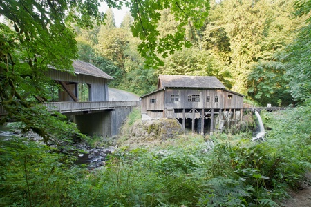 grist mill: Covered Bridge and Grist Mill Over Cedar Creek in Washington State Stock Photo