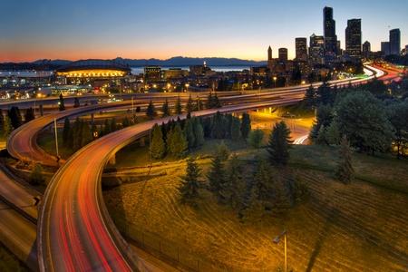 seattle skyline: Seattle Washington Downtown City Highway Light Trails at Sunset Stock Photo