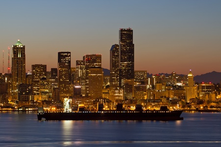 puget: Container Ship on Puget Sound along Seattle Washington Skyline at Dawn