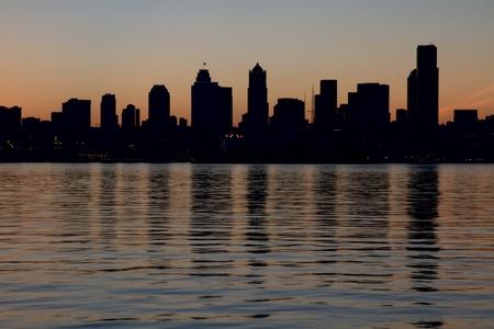 puget: Seattle Washington Downtown Skyline Silhouette along Puget Sound Stock Photo