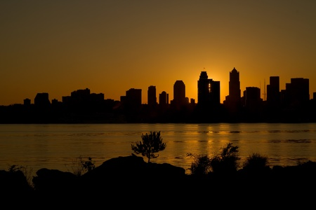 puget: Sunrise over Seattle Washington Skyline Along Puget Sound from Alki Beach Stock Photo