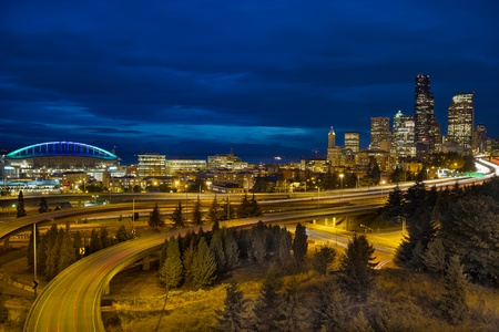 seattle: Seattle Downtown Skyline and Freeway Light Trails at Blue Hour Stock Photo