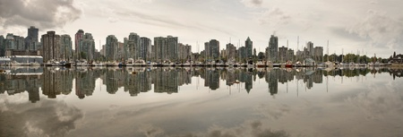 bc: Vancouver BC Canada Waterfront Skyline Reflection from Stanley Park Panorama Stock Photo
