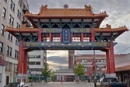 chinatown: Sunset at Chinatown Gate with Union Station in Seattle Washington