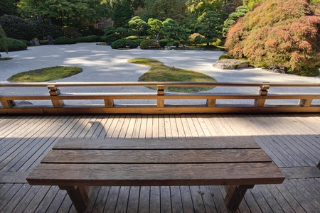 View of Japanese Sand Garden from Wooden Bench under Pavilion photo