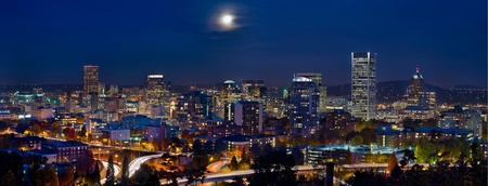 Moon Rise Over Portland Oregon City Skyline and Light Trails at Blue Hour photo