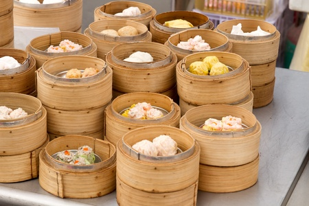 Steamed Dim Sum in Bamboo Trays by Local Street Food Vendors in Melaka Malaysia photo