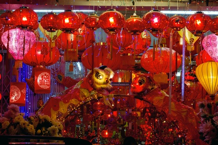 Storefront Displays of Chinese New Year Lanterns and Lion Dance along Street in Chinatown photo