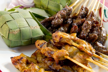malay food: Chicken and Lamb Satay Skewers with Ketupat Rice Wrapped in Coconut Leaf