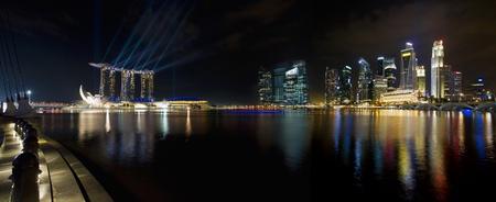 singapore city: Singapore City Skyline by the Esplanade at Night Panorama