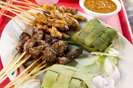 malay food: Chicken and Lamb Satay Skewers with Ketupat Rice and Peanut Sauce Stock Photo