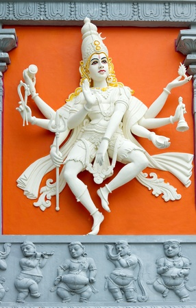 Hindu Goddess with Many Arms Statue on Wall of Sri Senpaga Vinayagar Temple photo