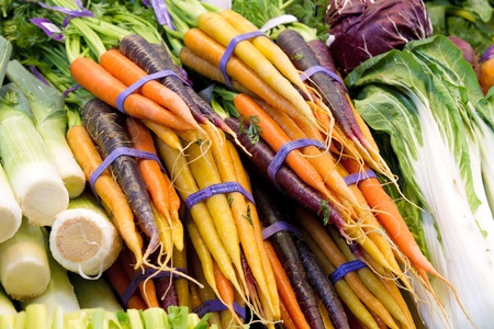 Organically Grown in the USA Carrots and Vegetable at Market Stall photo
