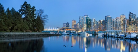 bc: Vancouver BC Canada Skyline and Marina along False Creek from Stanley Park at Blue Hour Panorama Stock Photo