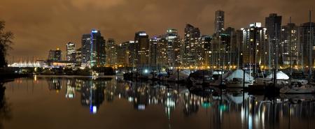 Vancouver BC Canada Skyline and Marina along False Creek at Night Panorama photo