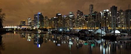 Vancouver BC Canada Skyline and Marina along False Creek at Night Panorama photo