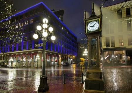 british weather: Gastown Steam Clock in Vancouver BC Canada on a Rainy Night