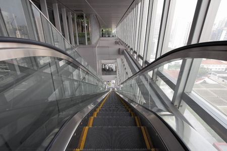 go inside: Long Generic Escalators in Public Library Going Up or Down Stock Photo