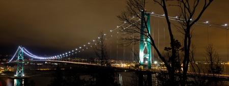 british columbia: Lions Gate Bridge Over Burrard inlet in Vancouver Bc Canada at night Panorama Stock Photo