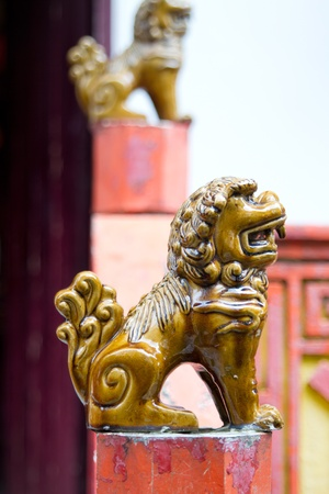Ceramic Foo Lion Statues on Posts Outside Chinese Temple