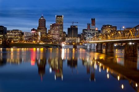 Portland Oregon Downtown City Skyline with Hawthorne Bridge along Willamette River at Blue Hour