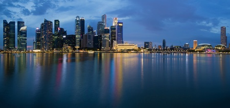 bay: Singapore City Skyline along Singapore River Panorama at Blue Hour Stock Photo