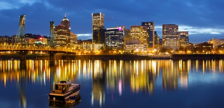 Portland Oregon Downtown Waterfront  Skyline along Willamette River at Blue Hour Twilight photo