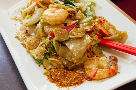 Thai Pad Kee Mao Rice Noodle with Prawns and Vegetable Dish And Side of Spicy Chili Powder Stock Photo - 13598004