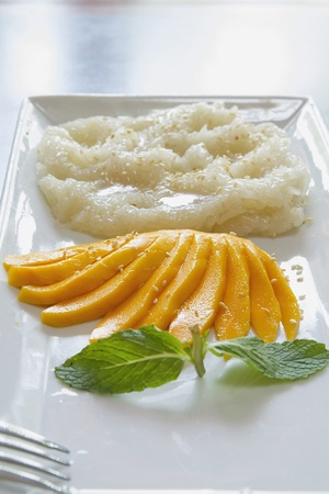Thai Sweet Mango with Sticky Rice and Coconut Sauce Dessert Vertical photo
